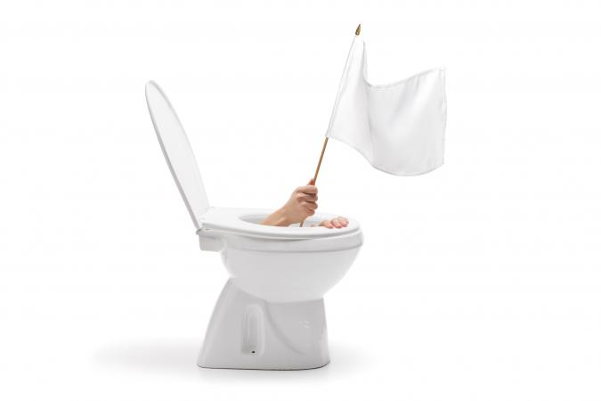 Hand with white flag coming out from toilet bowl