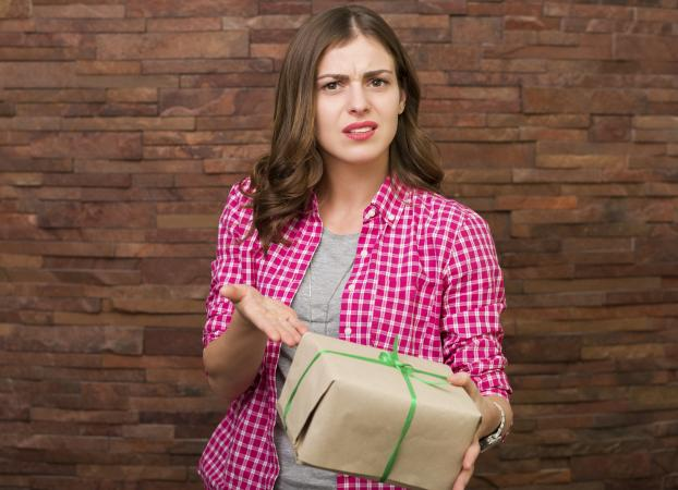 Woman holding present she doesn't need