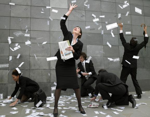 Business people catching falling money