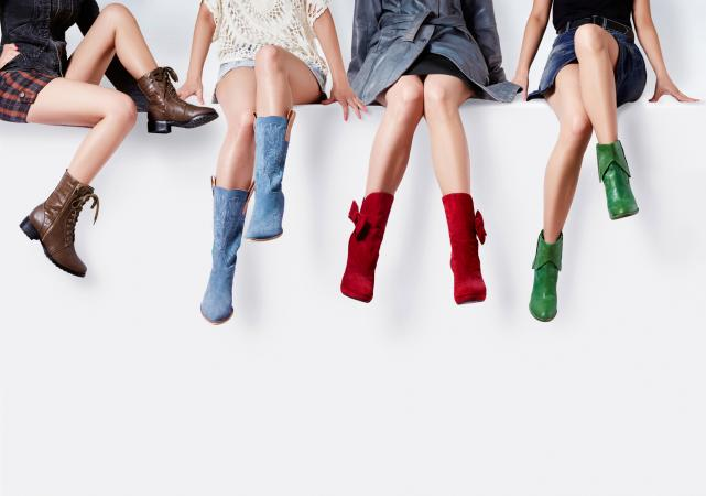 Image of women's legs in colorful boots