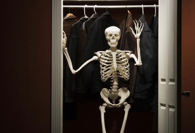 Skeleton standing in closet
