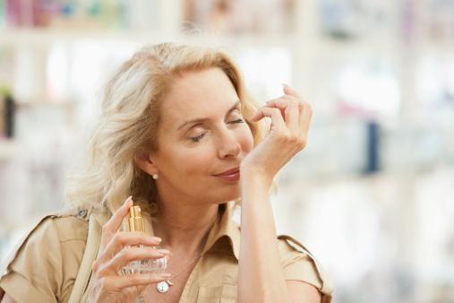 woman testing perfume