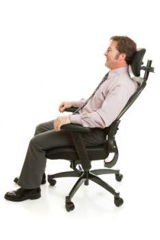 man in chair with lumbar support