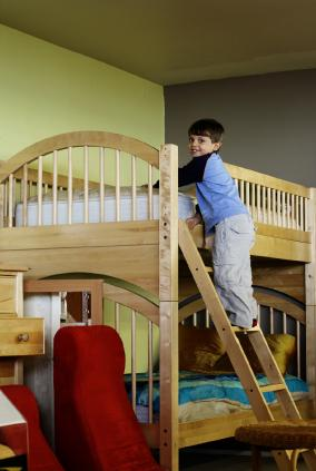 child on bunk bed