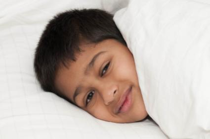 Young Boy in Bed