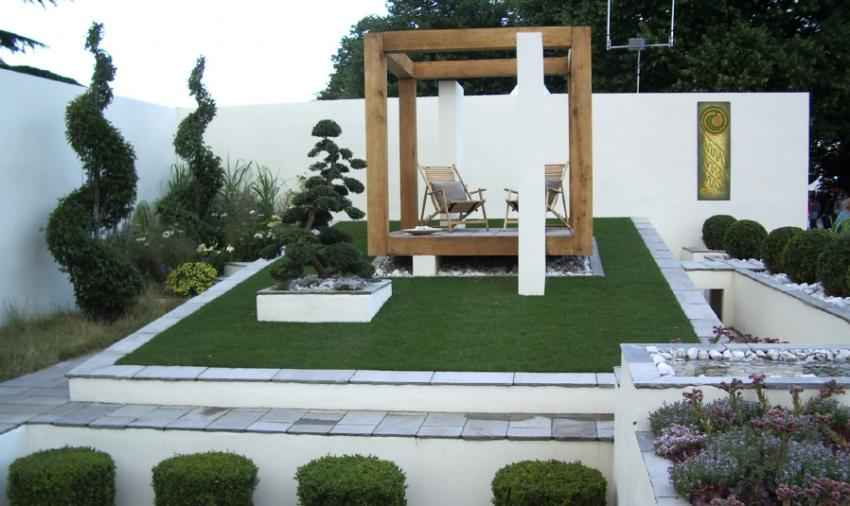Contemporary Home And Landscape Source · Garden With Modernist Patio Photo