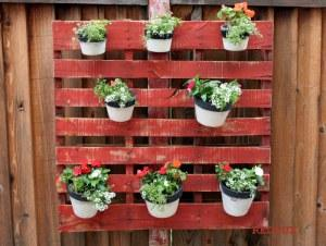 Pots hanging on a wooden pallet
