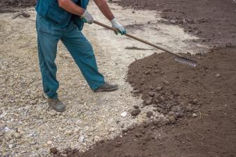 worker spreading soil