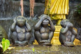 Wooden Statue Of Monkey In Garden
