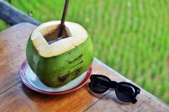 Fresh coconut water drink with straw
