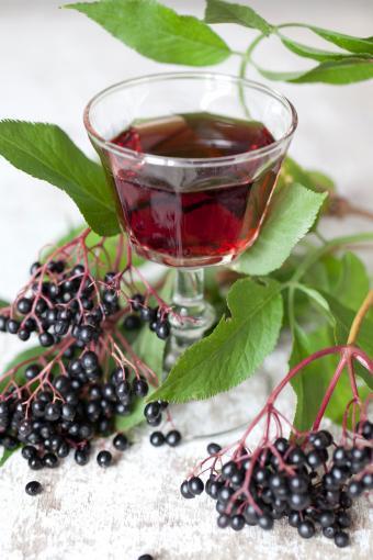 Elderberries and glass of juice