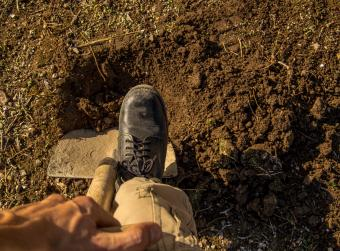 Man Digging Hole With Shovel