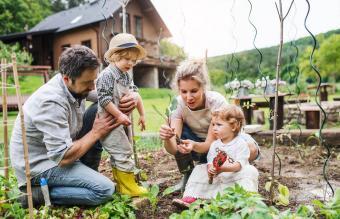 family outdoors gardening