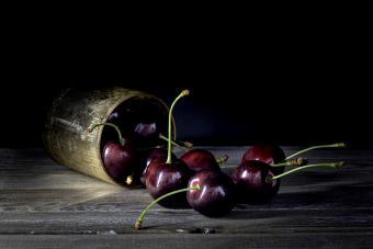 Dark cherries on rustic wood table top