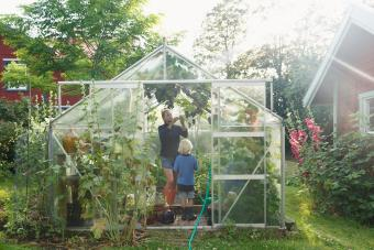 Mother with son in greenhouse