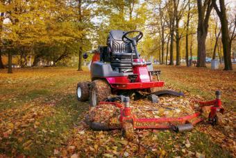 Lawn mower in autumn park