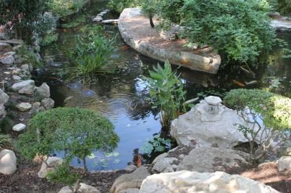 Garden ponds lovetoknow for Premade koi ponds
