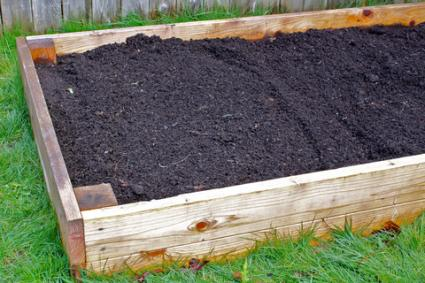 Raised Bed Frame Filled With Soil; Copyright Jebournon At Dreamstime.com