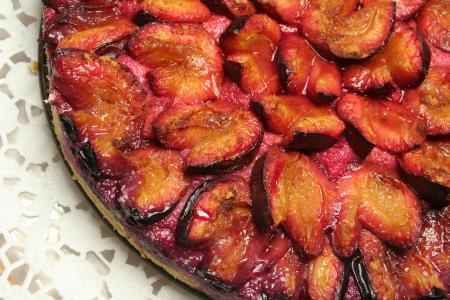 baked plum tart on a plate