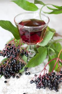 Elderberries and glass of juice