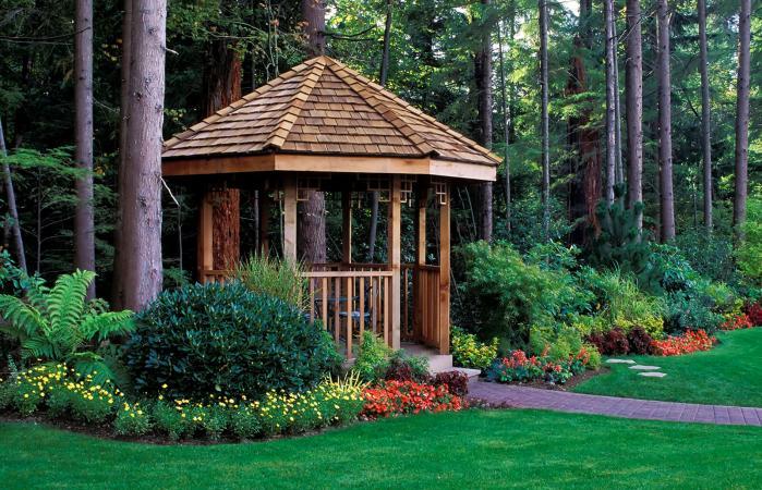 beautiful backyard garden with a cedar wood gazebo
