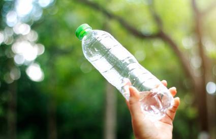 Hand holding an plastic bottle