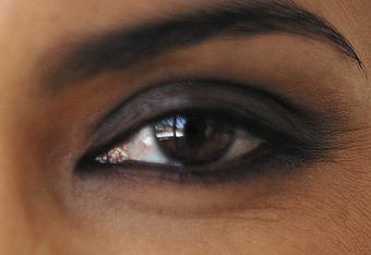 Dark brown eye closeup