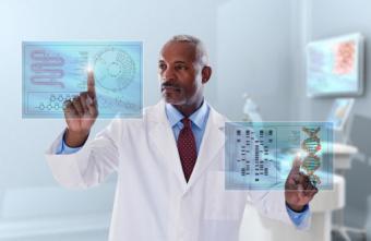 Doctor looking at digital display