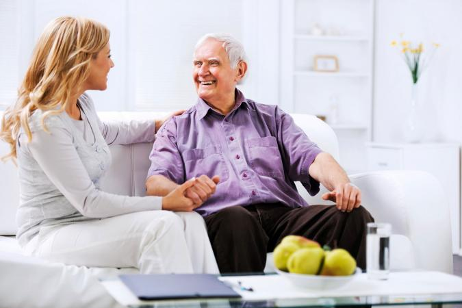 woman interviewing older man
