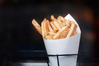 French fries in paper bundle