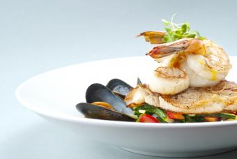 Seafood medley of shrimp, scallops, mussels and fresh fish over a bed of vegetables