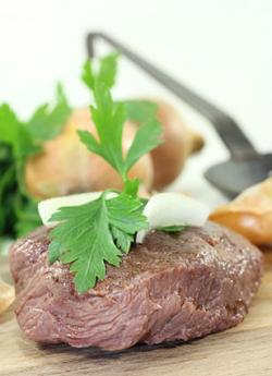Ostrich steak with onions
