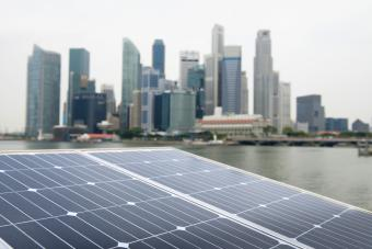 Modern city with solar panel in foreground
