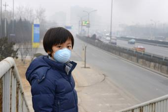 Boy wearing air pollution breathing mask