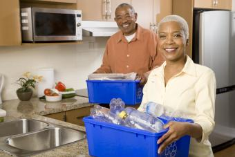 Couple in kitchen with recycling bins