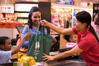 Using reusable bag in grocery store.