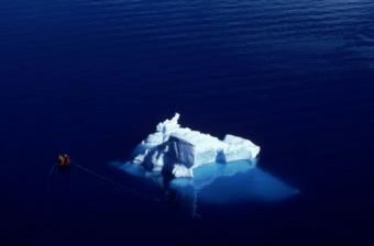 Aerial shot of boat and Iceberg in Paradise Bay, Antarctica