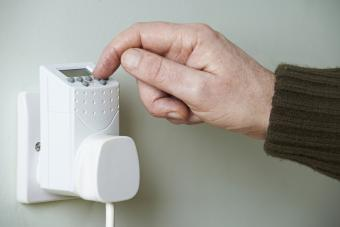 Adjusting vacation timer on electric outlet