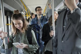 Standing passengers riding on a bus