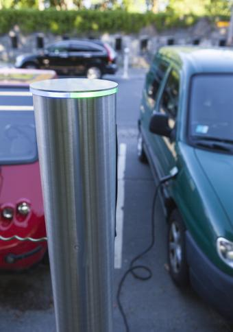 Electric car charging in parking lot
