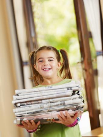 https://cf.ltkcdn.net/greenliving/images/slide/88417-375x500-kr_child_with_newspaper_.jpg