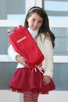 Girl carrying red Lyziwrap package