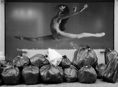 Ballerina leaping over trash bags