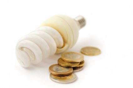 compact fluorescent light bulb and coins