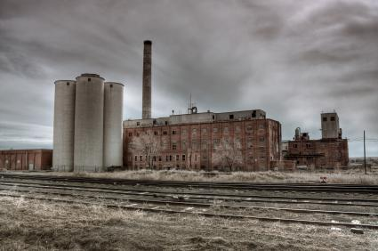 abandoned factory by railroad tracks