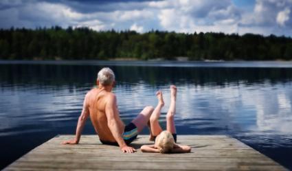 grandfather and grandson at lake
