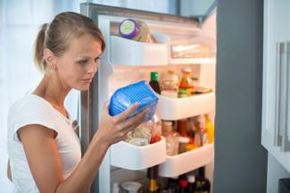 Woman looking at expiration date