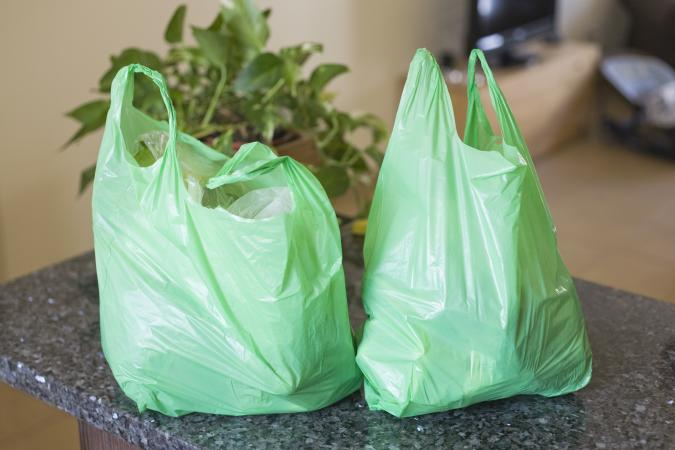 Green plastic grocery bags on counter