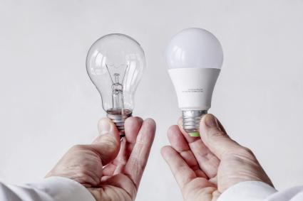 Incandescent light bulb versus LED lamp