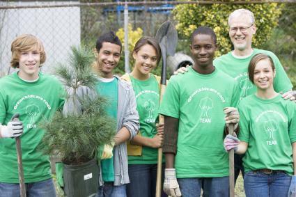 Volunteers planting a tree togethe